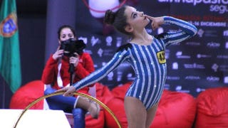 Illustration for article titled Spanish Rhythmic Gymnasts Competed In Bedazzled Concentration Camp-Style Leotards