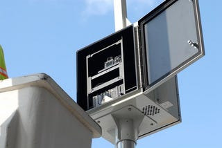 Illustration for article titled Brooklyn Couple Snags Nikon Traffic Cameras With Cherry Picker