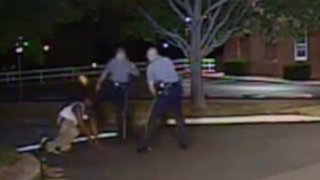 Dover, Del., Police Cpl. Thomas Webster IV was indicted by a grand jury on second-degree assault May 7, 2015, after dash-cam video appears to show Webster (center) kick Lateef Dickerson in the face in August 2013.Dover Police Department