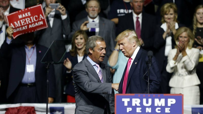 Farage and Trump at a campaign rally in Jackson, Mississippi in August. Photo via AP