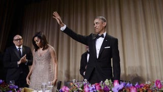 President Barack Obama waves to the audience after speaking at the White House Correspondents' Association annual dinner  April 30, 2016, at the Washington Hilton hotel in Washington, D.C. To his left are first lady Michelle Obama and host Larry Wilmore.Olivier Douliery-Pool/Getty Images