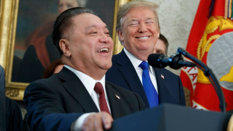 Donald Trump and Broadcom CEO Hock Tan at the White House in November 2017.``