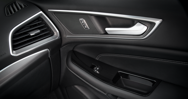 The interior of the 2015 Ford Edge, one of the vehicles the National Insurance Crime Bureau said was vulnerable to this strange hacking device. Image via Ford