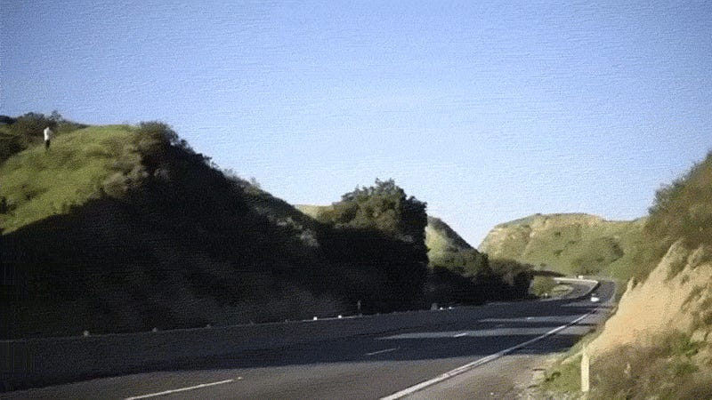 Daredevil dirt biker jumps across busy California freeway