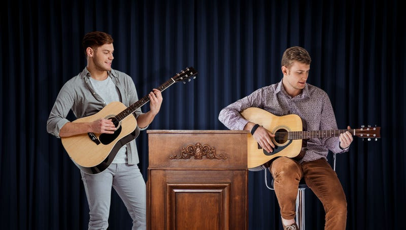 Nation's Men Holding Acoustic Guitars Announce Plan To Idly Strum While You Try To Talk To Them
