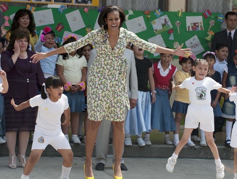 Illustration for article titled Michelle Obama Powers Through Another Day Of Doing Half-Assed Jumping Jacks In Middle School Gym