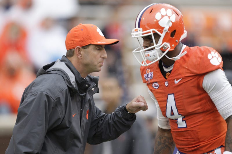 CLEMSON, SC - OCTOBER 10: Head Coach Dabo Swinney of the Clemson Tigers talks with quarterback Deshaun Watson #4 prior to their game against the Georgia Tech Yellow Jackets at Memorial Stadium on October 10, 2015 in Clemson, South Carolina. (Photo by Tyler Smith/Getty Images)