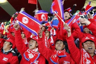 """Illustration for article titled North Korean Soccer Fans Are Actually Chinese """"Volunteers"""" (UPDATE)"""