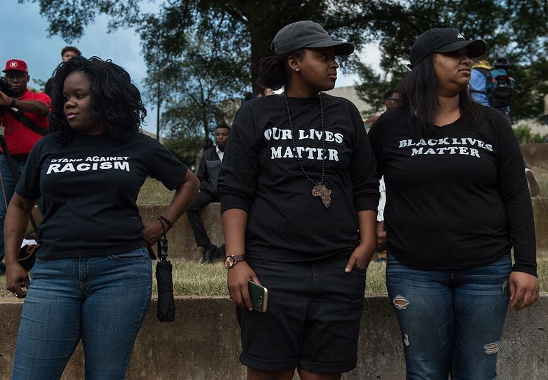 Protesters look on during a demonstration against police brutality in Charlotte, N.C., on Sept. 21, 2016, following the shooting of Keith Lamont Scott.NICHOLAS KAMM/AFP/Getty Images