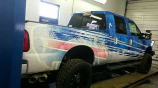 Illustration for article titled Rex Ryan Got A Giant Bills Logo Painted On His Truck