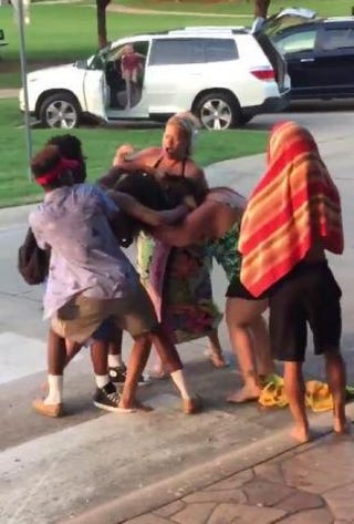 A woman, identified as CoreLogic Inc. employee Tracey Carver, is shown in a video apparently involved in the initial altercation that prompted police response to a pool party in McKinney, Texas, June 5, 2015.YouTube screenshot