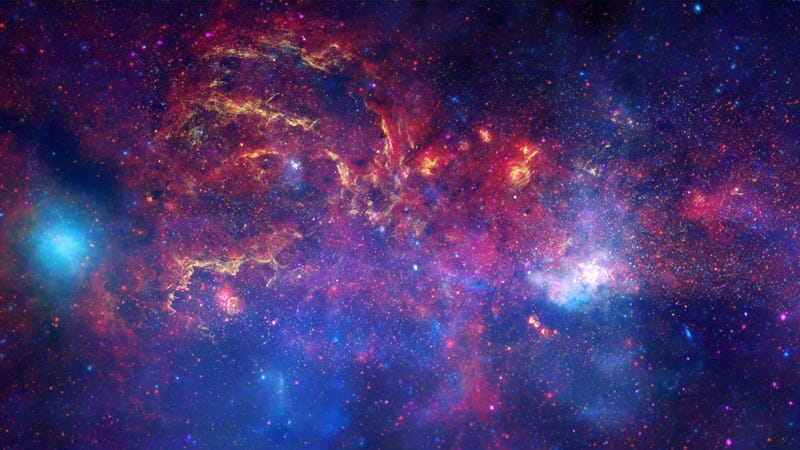 Illustration for article titled Stunning Milky Way's Heart Image Combines Three Space Telescope Views In One