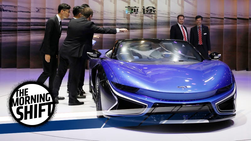 The Chinese carmaker Qiantu stand showing off the company's all-electric roadster. Photo Credit: AP