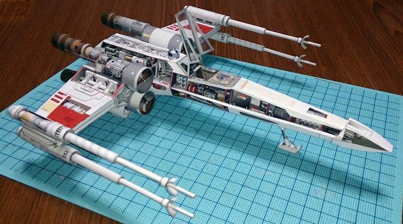 Illustration for article titled Japanese craftsman creates perfect sci-fi ship replicas using just paper