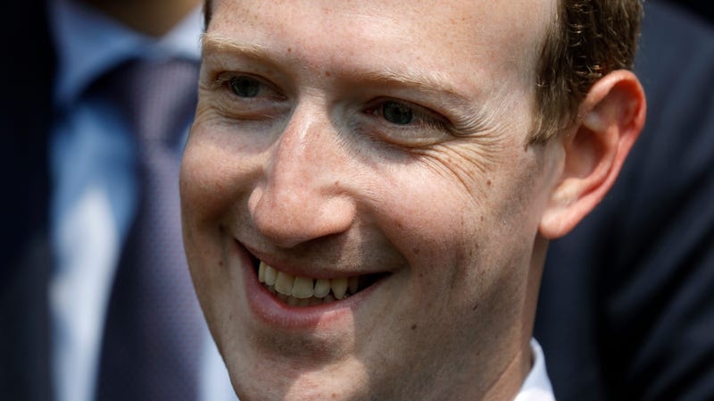 """Facebook's CEO Mark Zuckerberg smiles during a picture with guests attending the """"Tech for Good"""" Summit at the Elysee Palace in Paris in May of 2018."""