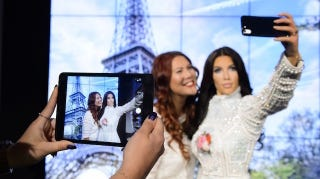 Illustration for article titled Of Course Kim Kardashian Now Has a Selfie-Taking Wax Figure
