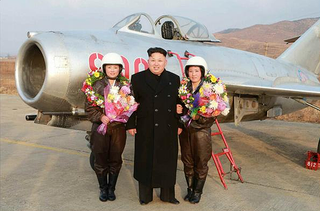 Illustration for article titled Kim Jong Un Visits Female Fighter Pilots, Picks Up Camera For Photo Op