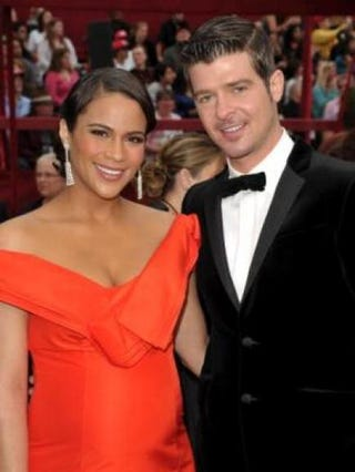 Actress Paula Patton and singer Robin Thicke arrive at the 82nd annual Academy Awards at the Kodak Theatre (now called the Dolby Theatre) on March 7, 2010, in Hollywood, Calif. John Shearer/Getty Image