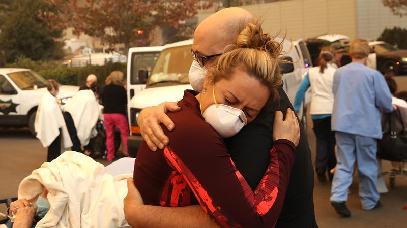 Hospital workers evacuate patients during the Camp Fire.