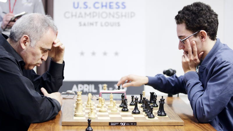 Fabiano Caruana (right) plays against legendary grandmaster Garry Kasparov (left). Photo credit: AP