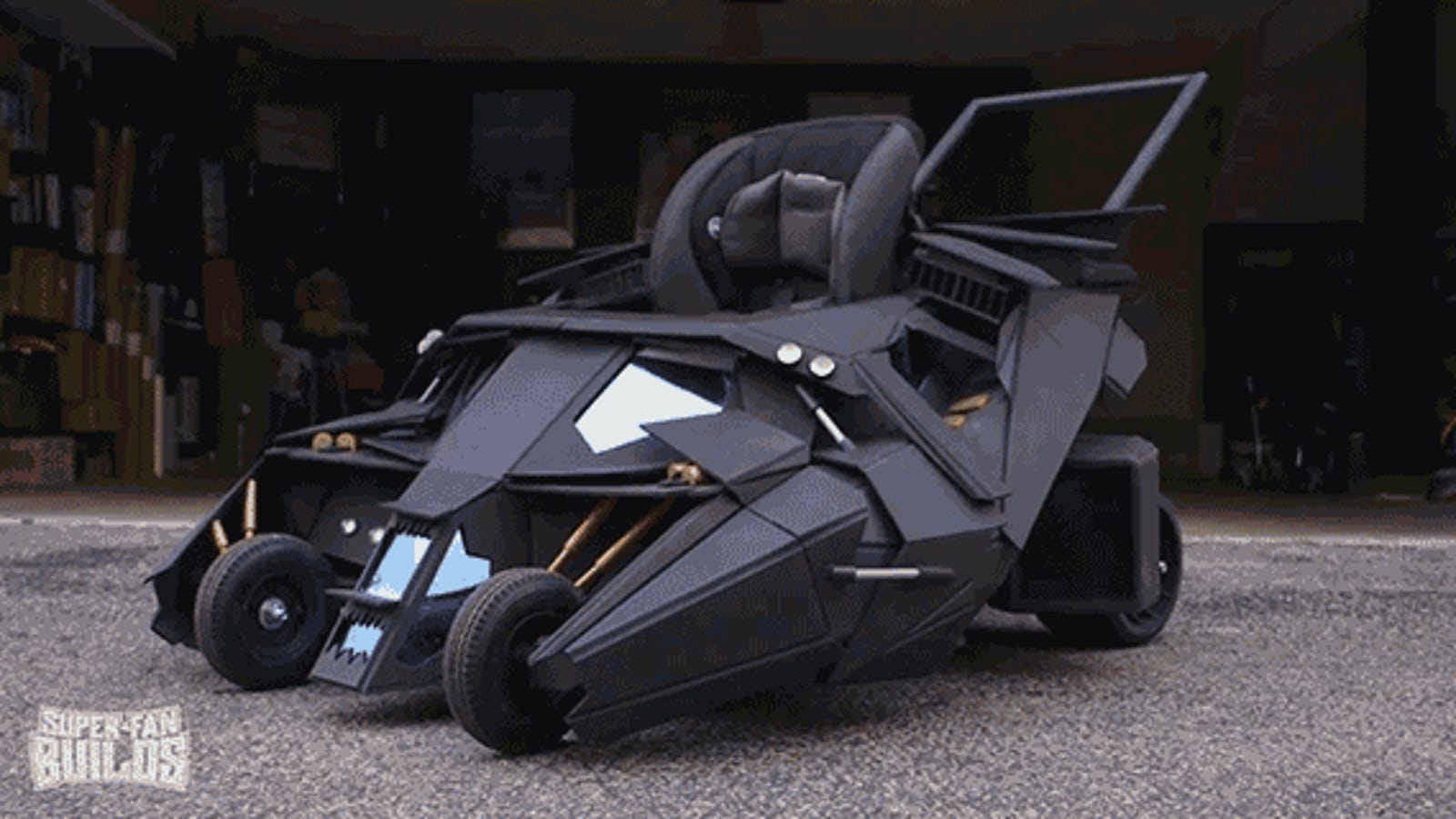 Prepare To Be Insanely Jealous Of This Toddler's Batmobile Stroller