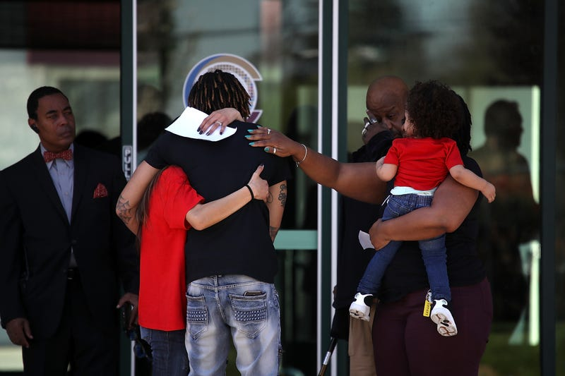 Mourners embrace as they leave a wake for Stephon Clark at the Boss Church on March 28, 2018, in Sacramento, Calif.