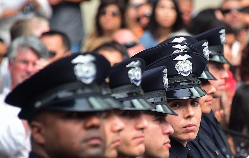 Police recruits attend their graduation ceremony at LAPD headquarters where rappers Snoop Dogg and the Game led a peaceful demonstration outside on July 8, 2016.FREDERIC J. BROWN/AFP/Getty Images