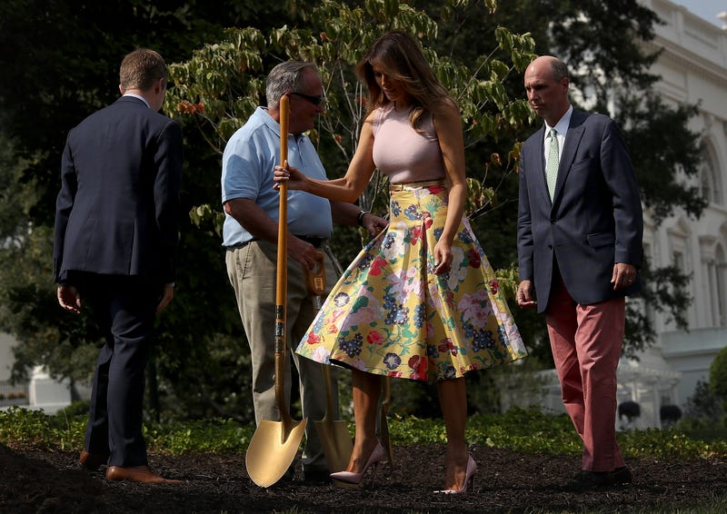 Illustration for article titled Here's Melania, Planting a Tree in a $4,000 Skirt Just Like You Do