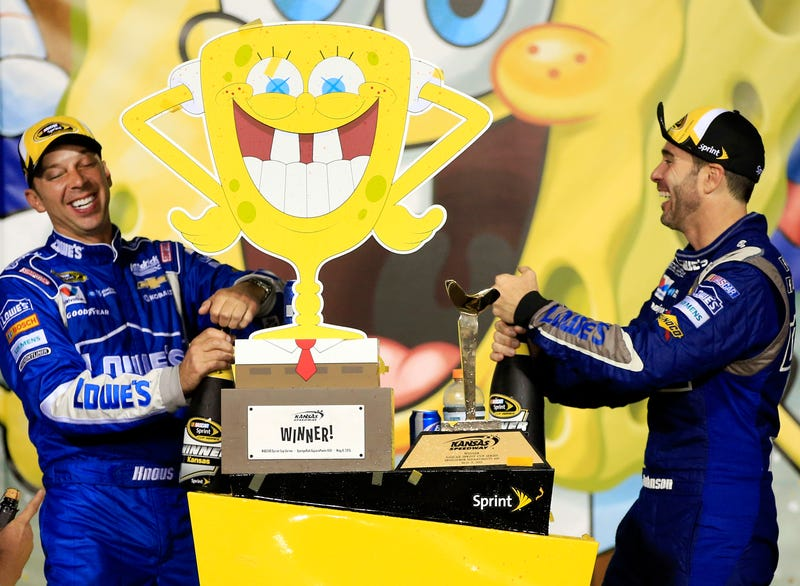 Who lives in a pineapple under the sea? Not these guys, obviously. Jimmie Johnson and Chad Knaus celebrate after winning the 2015 SpongeBob Squarepants 400 at Kansas Speedway. Photo credit: Jamie Squire, Getty Images