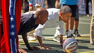 President Barack Obama (right) does pushups with retired NBA star Bruce Bowen during the annual Easter Egg Roll on the White House tennis court in Washington, D.C., on April 9, 2012.Chip Somodevilla/Getty Images