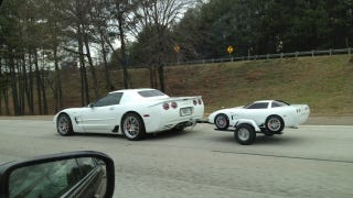 Somewhere Outside Of Atlanta There Is A Corvette With Trailer Hitch Towing Mini Vette Drivers Beware As Its Intense Cuteness Could Lead To Dangerous