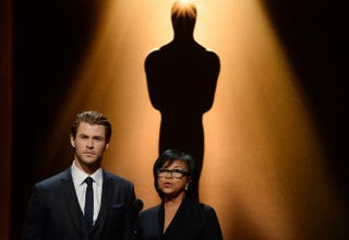 Actor Chris Hemsworth and Academy of Motion Picture Arts and Sciences President Cheryl Boone Isaacs speak at the 86th Academy Awards nominations announcement Jan. 16, 2014, in Beverly Hills, Calif. ROBYN BECK/AFP/Getty Images