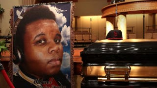 The casket of Michael Brown sits inside Friendly Temple Missionary Baptist Church awaiting the start of his funeral Aug. 25, 2014, in St. Louis. Brown, an 18-year-old unarmed teenager, was shot and killed by Police Officer Darren Wilson in the nearby town of Ferguson, Mo., on Aug. 9, 2014.Robert Cohen-Pool/Getty Images