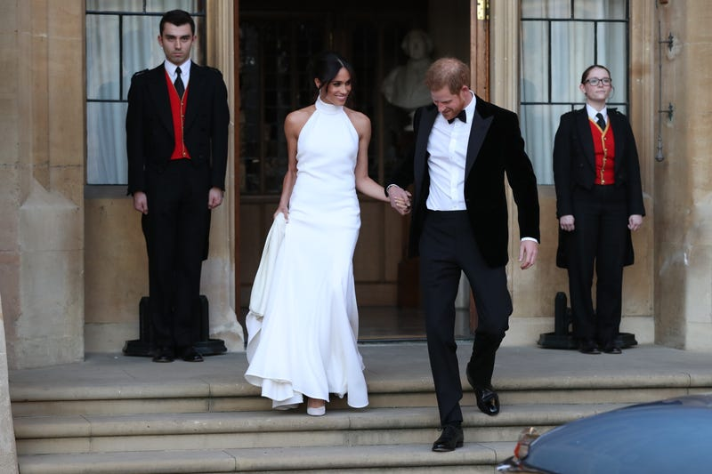 Prince Harry, duke of Sussex, and his new bride, the duchess of Sussex, leave Windsor Castle after their wedding May 19, 2018, to attend an evening reception at Frogmore House, hosted by the prince of Wales, in Windsor, England.