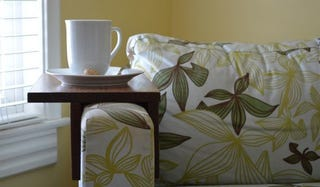 Illustration for article titled DIY Wooden Couch Sleeves Make the Perfect Spot for Your Drink