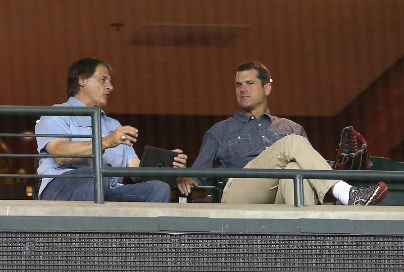 Illustration for article titled Jim Harbaugh Attended Another Baseball Game With His Favorite Glove
