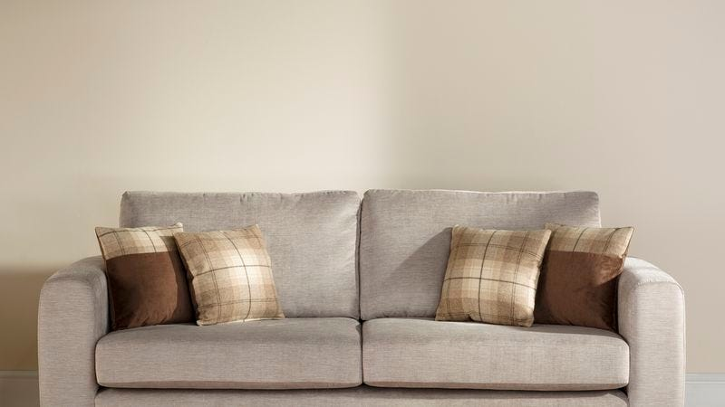 Illustration for article titled Empty Wall Behind Couch Falls Into Girlfriend's Crosshairs