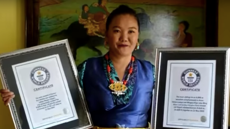 Lhakpa Sherpa holds her certificates from the Guinness Book Of World Records