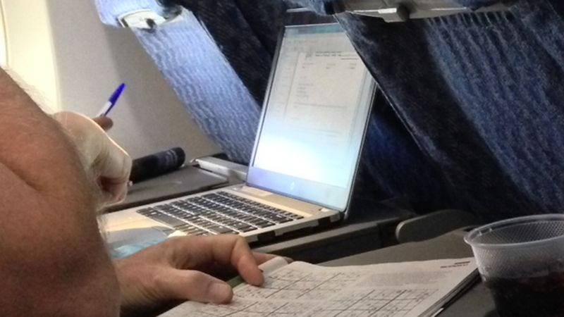 Illustration for article titled Everything We Know About The Guy Sitting Next To Us On The Plane Based On The Times We've Glanced At His Computer Screen