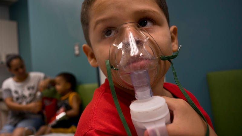 A Puerto Rican boy receives asthma treatment.