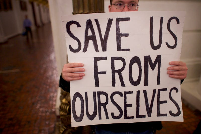 A Donald Trump protester joins demonstrators inside the Pennsylvania Capitol before electors arrive to cast their votes from the election on Dec. 19, 2016, in Harrisburg, Pa.Mark Makela/Getty Images