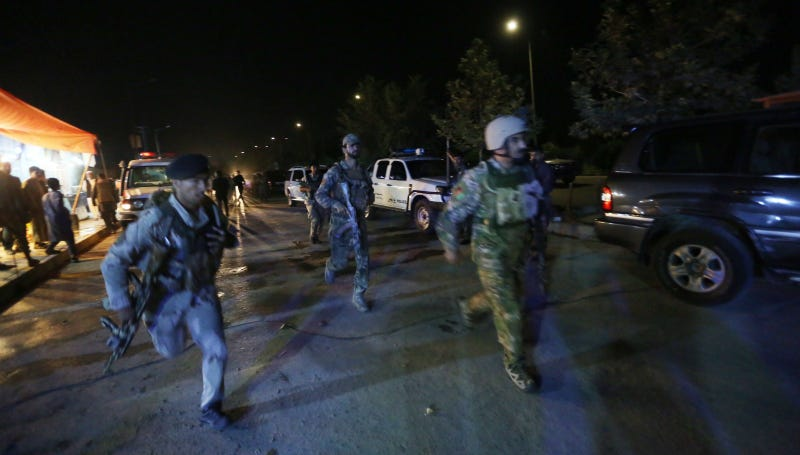 Afghan security forces heading to the scene of the attack. Photo via AP.