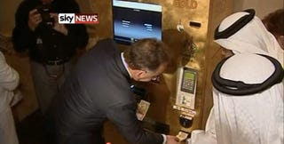 Illustration for article titled Just You Try Hacking This Gold Bar-Dispensing ATM In Abu Dhabi