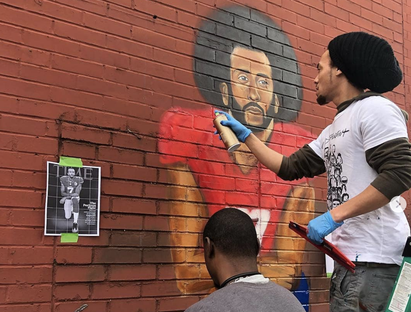 "Artists paint a mural of former NFL quarterback Colin Kaepernick during ""Kaeper Bowl"" in Atlanta."