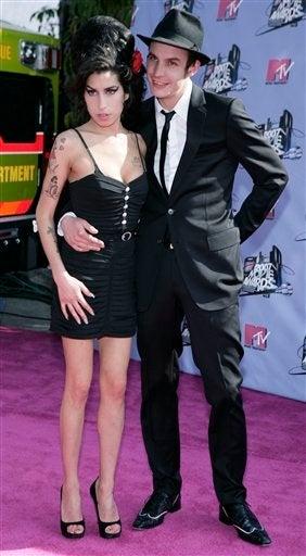 """Illustration for article titled Amy Winehouse: """"I Won't Let Blake Divorce Me"""""""