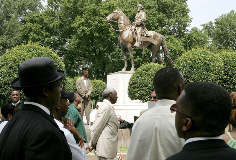 Protesters rally against the name of Nathan Bedford Forrest Park in front of a statue bearing his likeness Aug. 13, 2005, in Memphis, Tenn. The park's name was changed in 2016. In December 2017, the statue of Forrest himself came down.