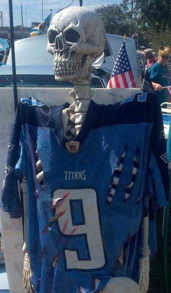 Illustration for article titled Why Yes, Jaguars Fans Tailgated With A Skeleton In A Bloody And Torn Steve McNair Jersey