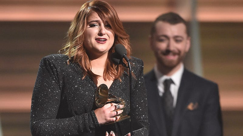 Real love: Sam Smith beams as Meghan Trainor accepts Best New Artist at the 2016 Grammys