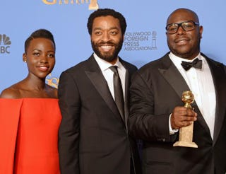 Lupita Nyong'o, Chiwetel Ejiofor and Steve McQueenROBYN BECK/AFP/Getty Images