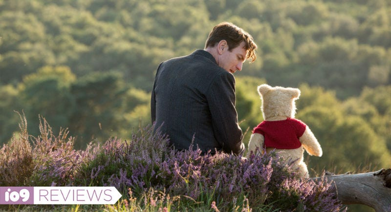 Christopher Robin (Ewan McGregor) and Winnie the Pooh (Jim Cummings) enjoy a moment in Christopher Robin.